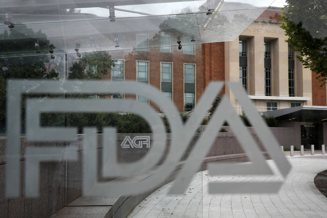 An Aug. 2, 2018, file photo shows the U.S. Food and Drug Administration building behind FDA log ...
