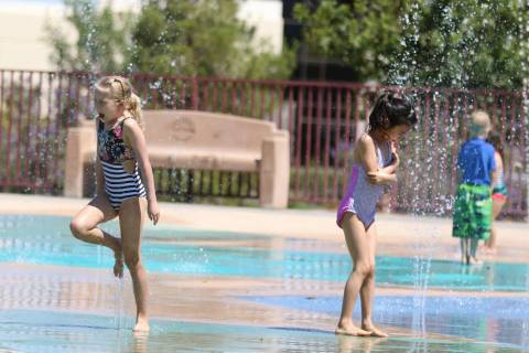 Maye Spann, 6, left, and her friend Stella Huang, 7, play at Paseo Vista Park on Monday, June, ...