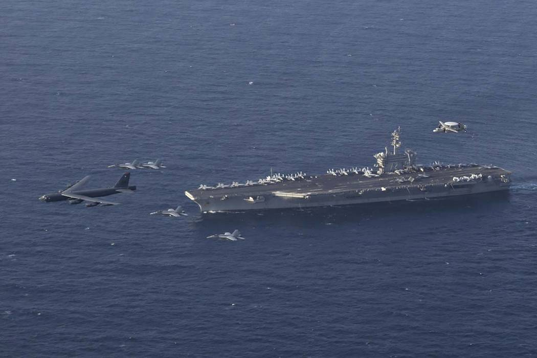 The USS Abraham Lincoln carrier and a U.S. Air Force B-52H Stratofortress, conduct joint exerci ...