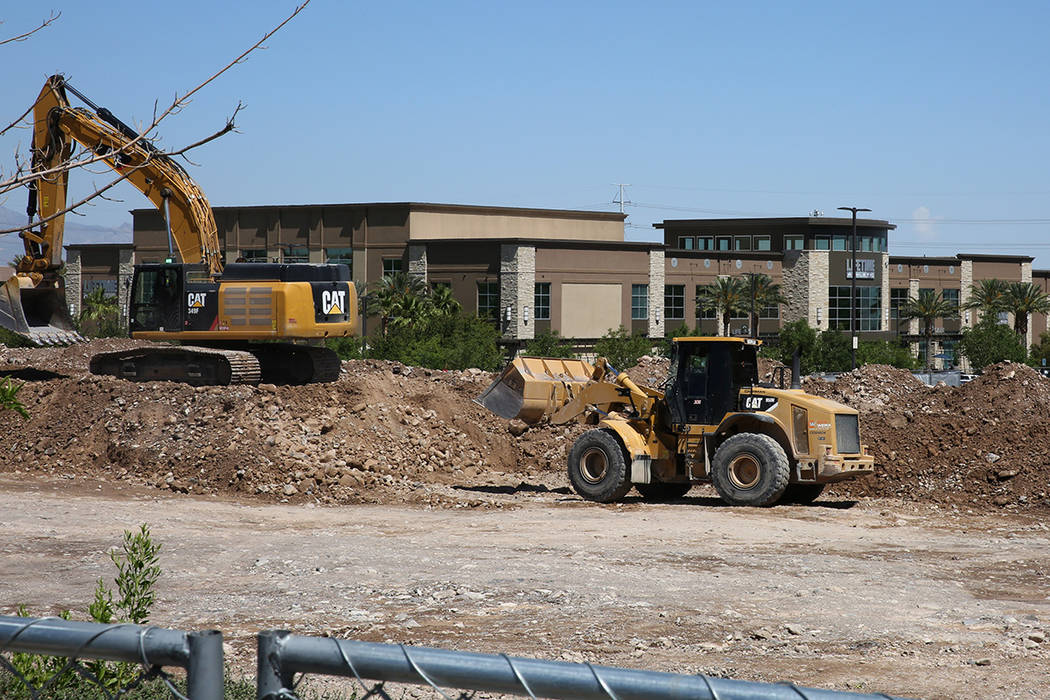 A luxury apartment complex construction site behind Lifetime Athletic is seen on Monday, June, ...