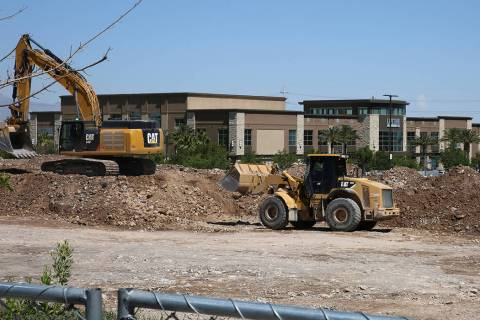 A luxury apartment complex construction site behind Life Time Athletic is seen on Monday, June, ...