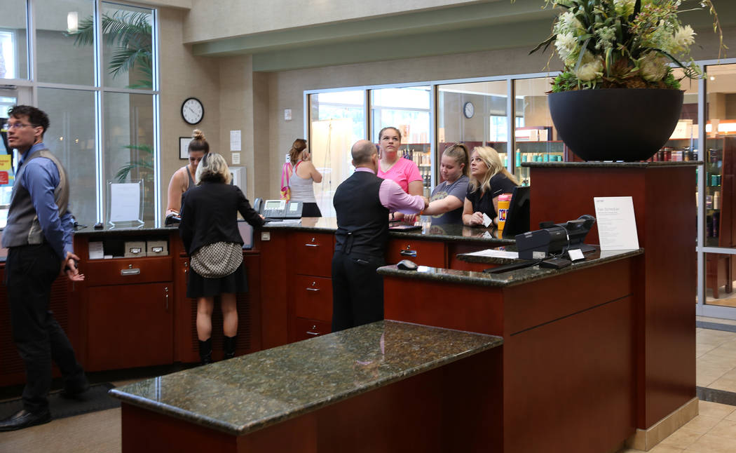 Members sign in at Lifetime Athletic's front desk on Monday, June, 3 2019, in Henderson. (Bizua ...