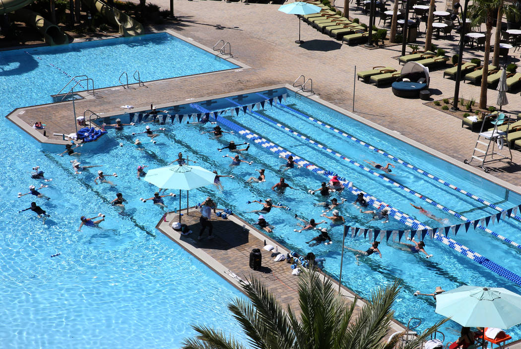 Members at Lifetime Athletic participate in Aquatic exercise on Monday, June, 3 2019, in Hender ...