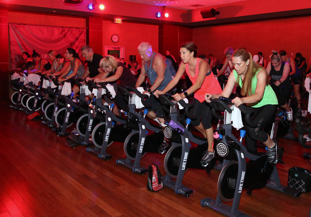 Members at Lifetime Athletic exercise during spinning class on Monday, June, 3 2019, in Henders ...