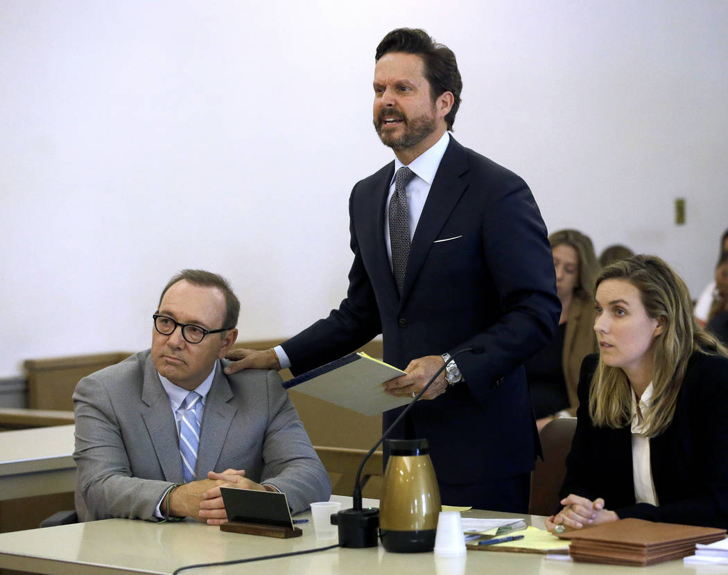 Actor Kevin Spacey, left, listens to attorney Alan Jackson address the court during a pretrial ...