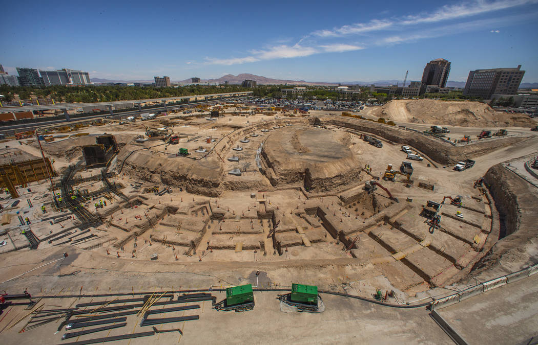 Construction continues on the basement level with pilings in place and the circle defined for t ...