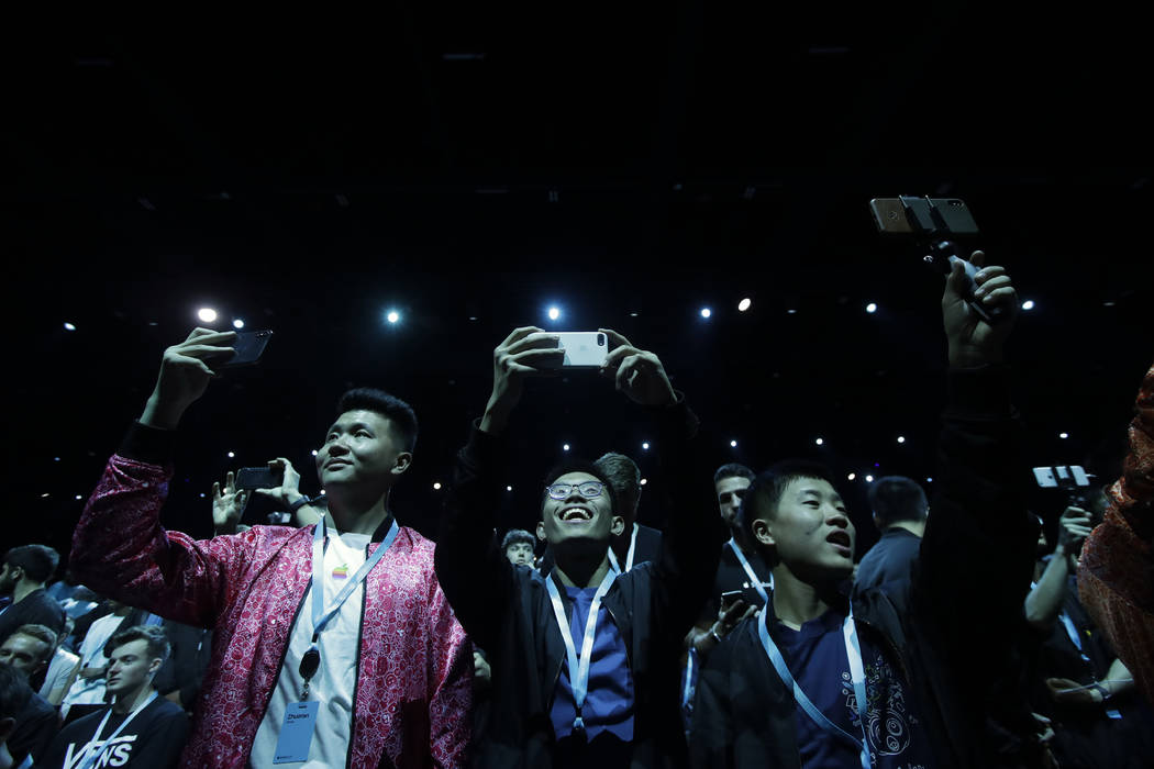 Attendees await the start of the keynote address at the Apple Worldwide Developers Conference i ...