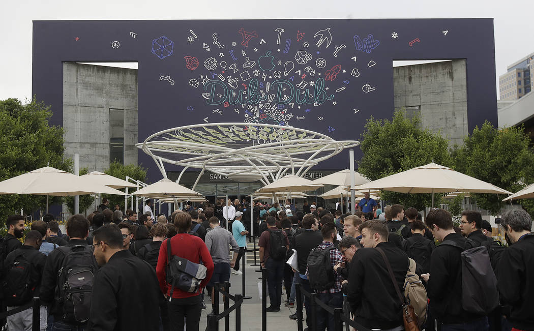 A crowd waits in line before an announcement at the Apple Worldwide Developers Conference in Sa ...