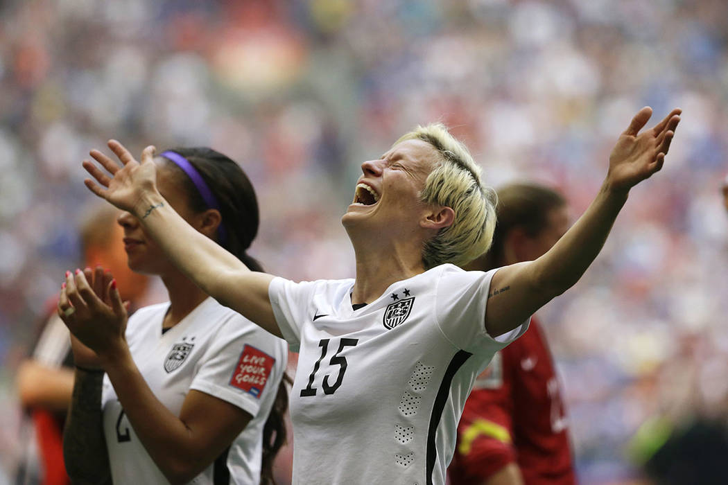 FILE - In this July 5, 2015, file photo, United States' Megan Rapinoe celebrates after the U.S. ...