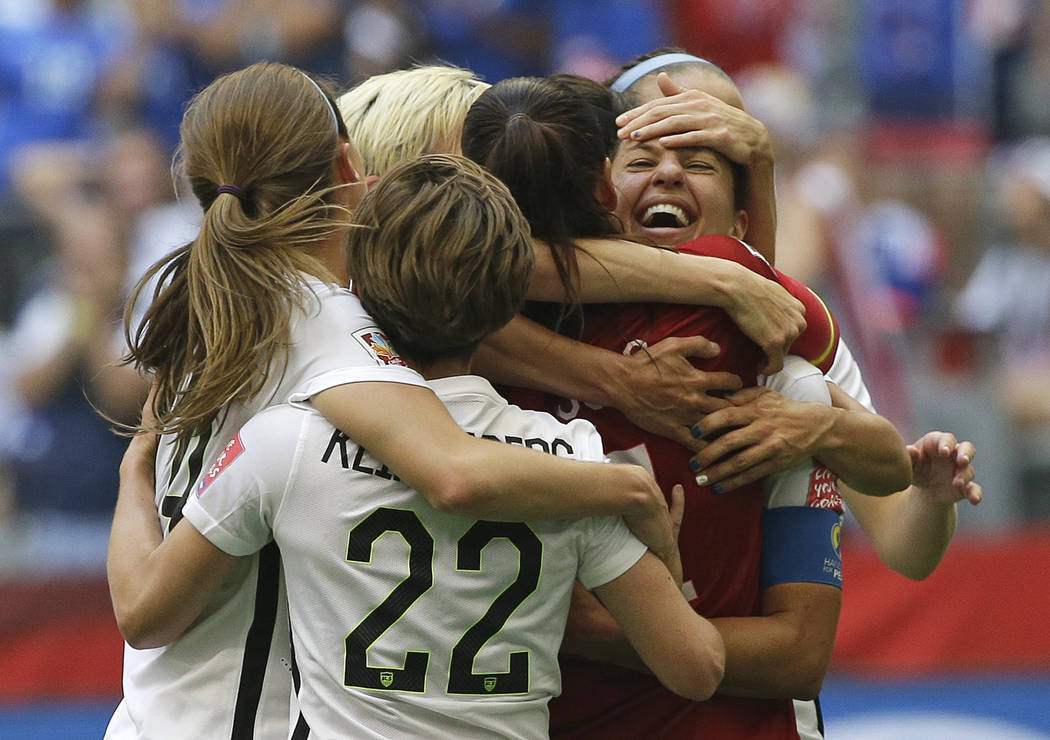 FILE - In this July 5, 2015, file photo, United States' Carli Lloyd, right, celebrates with tea ...