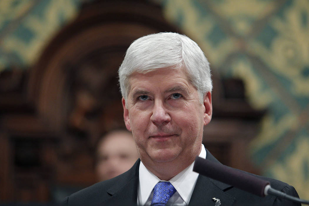 FILE - In this Tuesday, Jan. 23, 2018, file photo, Michigan Gov. Rick Snyder delivers his State ...
