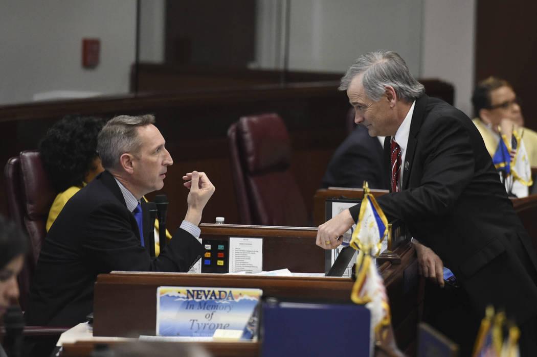 Nevada State Senators Scott Hammond, left, and James Settelmeyer chat during a break on the Sen ...
