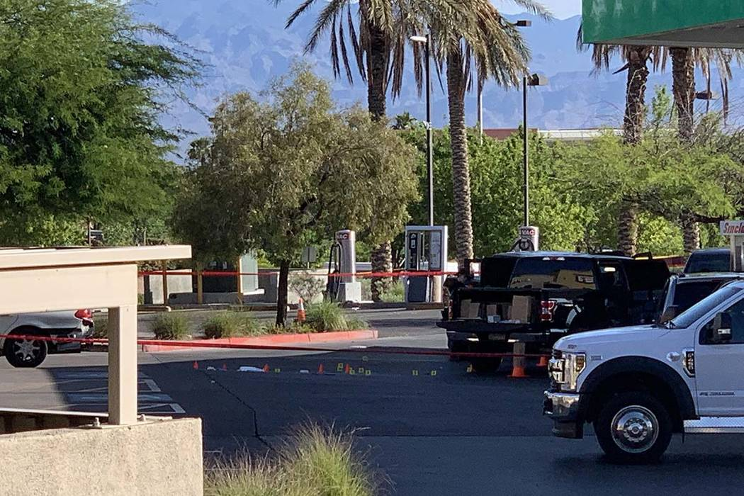 Las Vegas police investigate after an officer-involved shooting at a Sinclair station at Coving ...