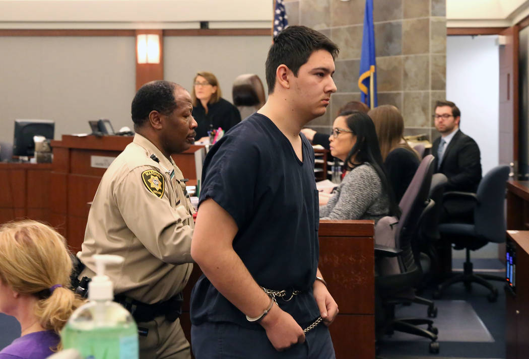 Maysen Melton, accused of raping classmates, is lead out of the courtroom after his bail hearin ...