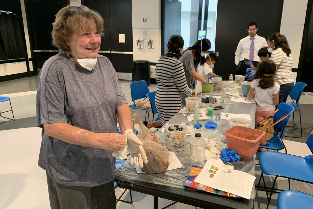 Susan Greene, 69, an attendee at the hypertufa pot making event, prepares to cleanup after crea ...