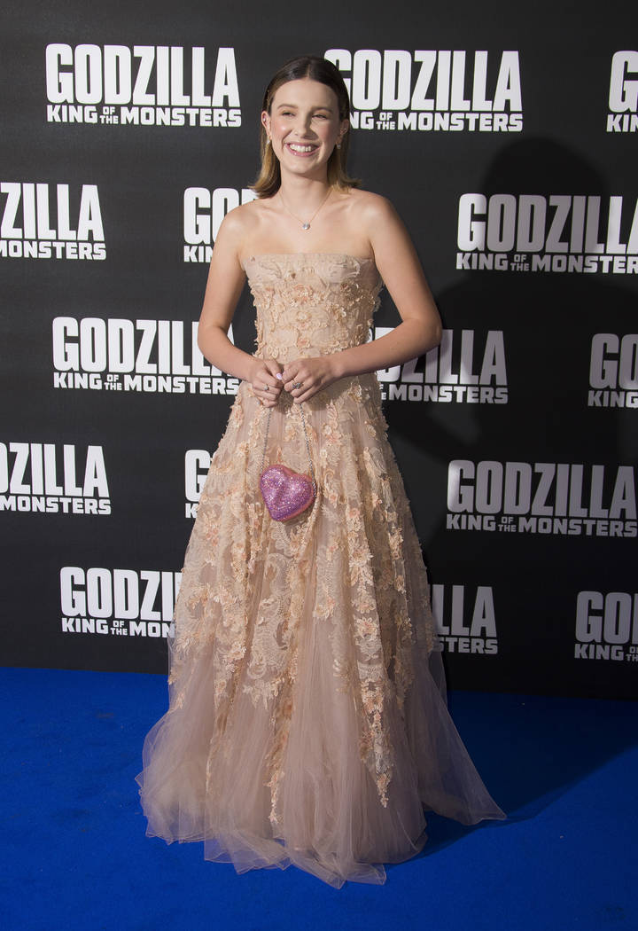 Actress Millie Bobby Brown poses for photographers upon arrival at the screening for Godzilla I ...