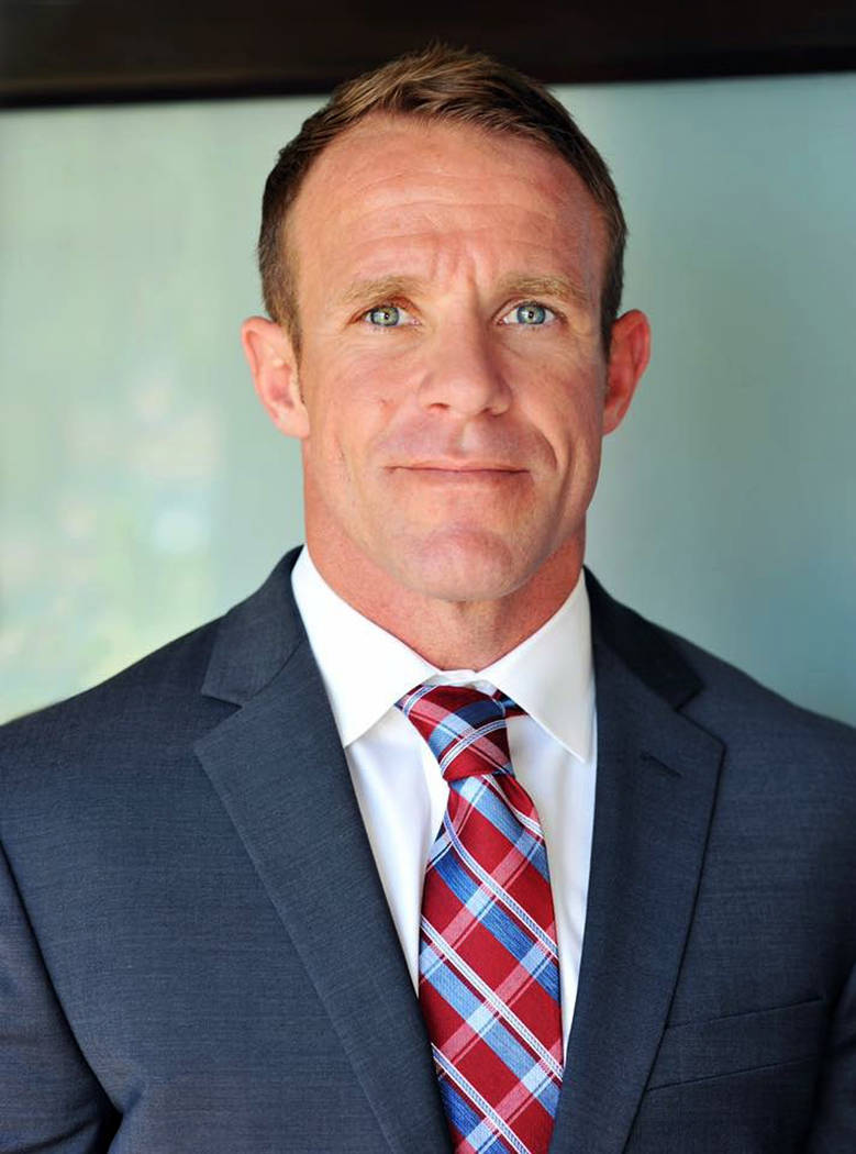 FILE - This 2018 file photo provided by Andrea Gallagher shows her husband, Navy SEAL Edward Ga ...