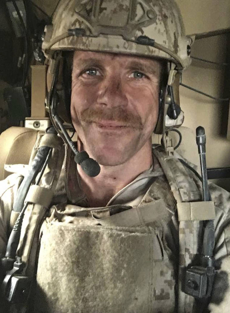 This undated selfie photo provided by Andrea Gallagher shows her husband, Navy SEAL Edward Gall ...