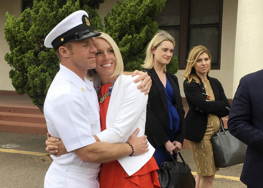 Navy Special Operations Chief Edward Gallagher, left, hugs his wife, Andrea Gallagher, after le ...