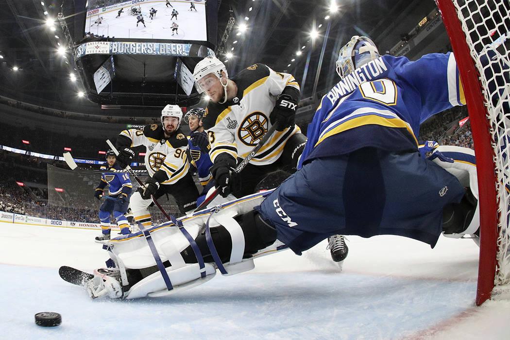 Boston Bruins center Charlie Coyle (13) scores a goal against St. Louis Blues goaltender Jordan ...