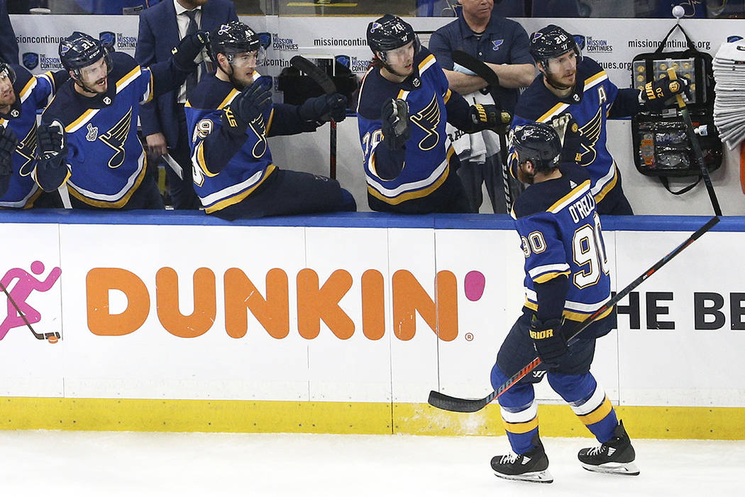 St. Louis Blues center Ryan O'Reilly (90) is congratulated after scoring a goal against the Bos ...