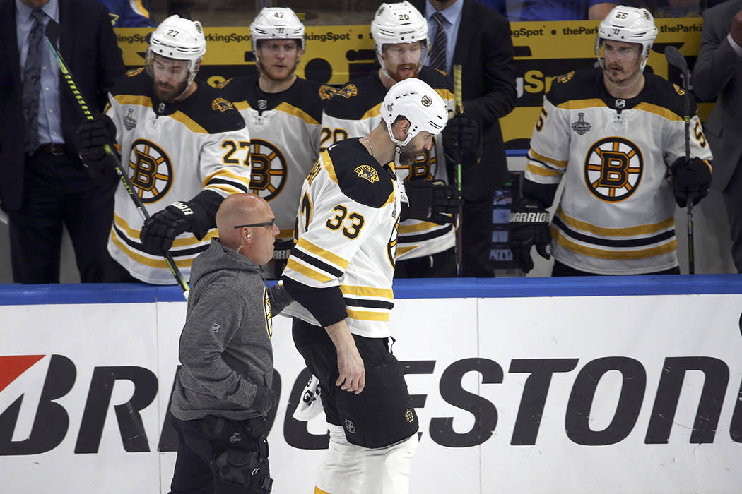 Boston Bruins defenseman Zdeno Chara (33), of Slovakia, leaves the ice after being hit in the f ...