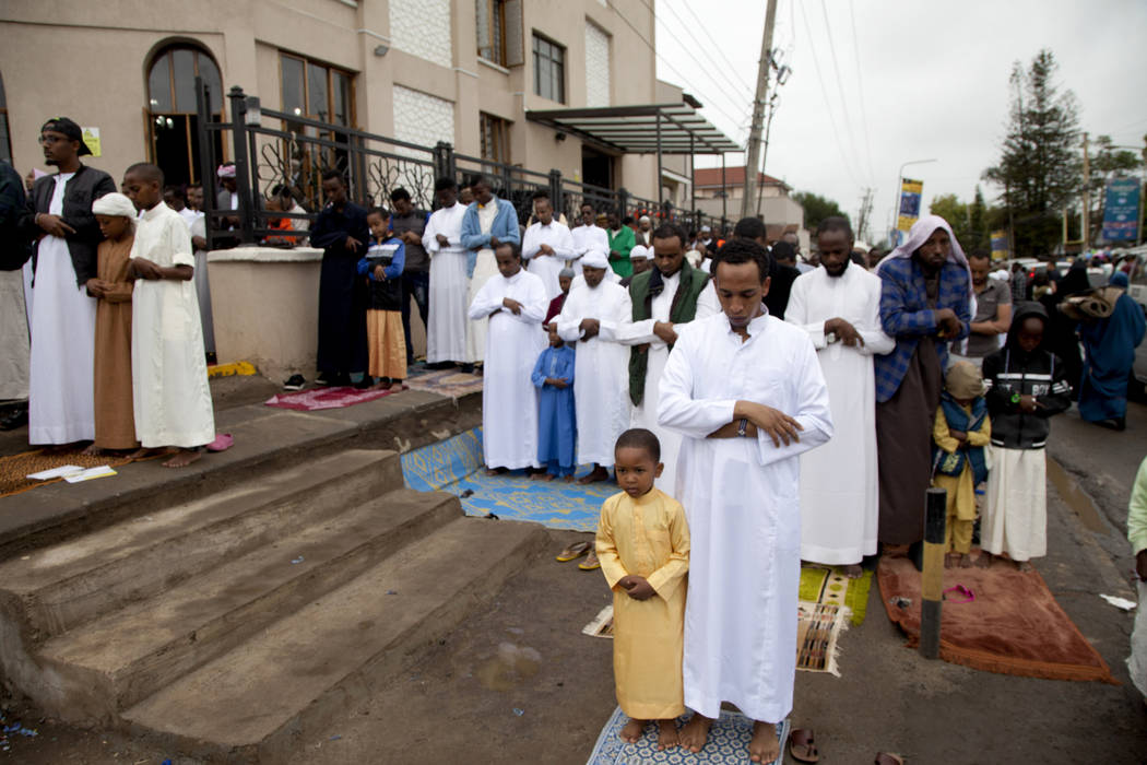 Kenyan Muslims stand for prayers outside Masjid As Salaam during the Eid al-Fitr prayers in Nai ...