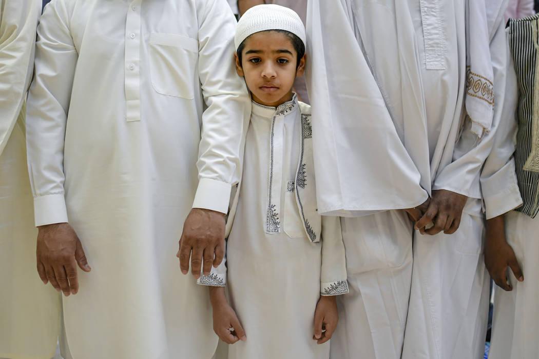 A boy attends Eid al-Fitr prayers in Bucharest, Romania, Tuesday, June 4, 2019. Members of the ...