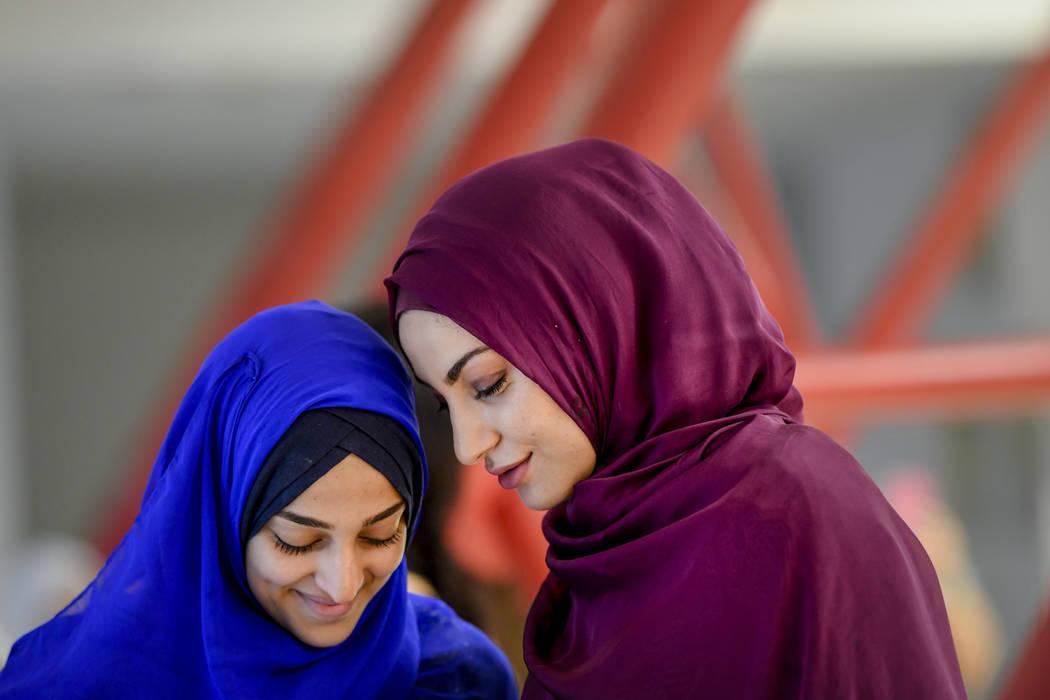 Girls wait for the start of Eid al-Fitr prayers in Bucharest, Romania, Tuesday, June 4, 2019. M ...