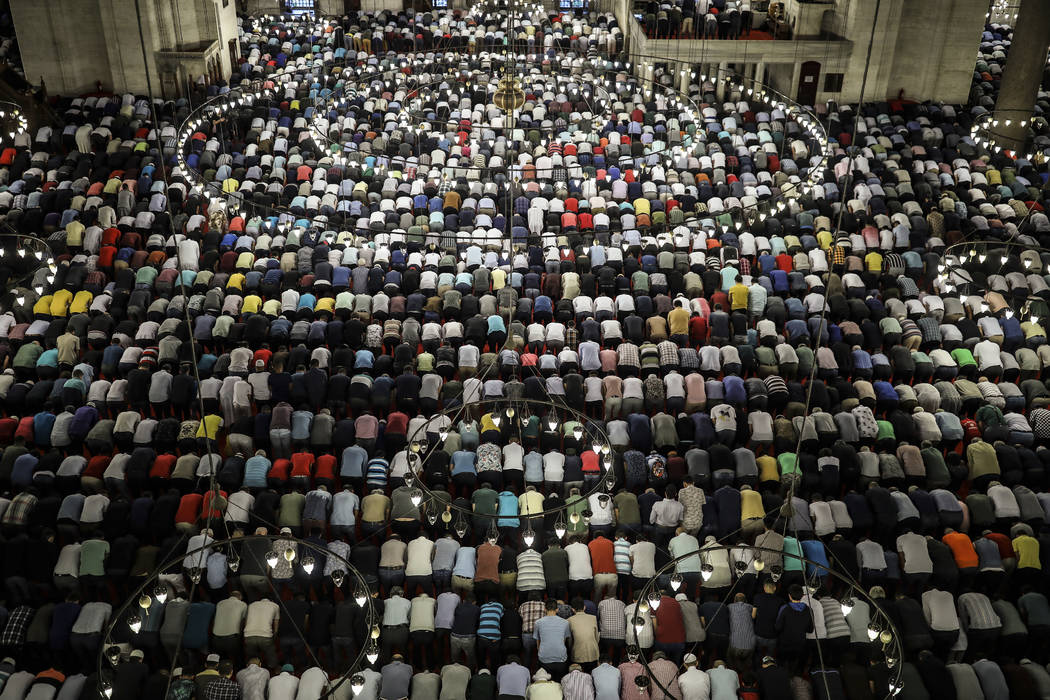 Turkey's Muslims offer prayers during the first day of Eid al-Fitr, which marks the end of the ...