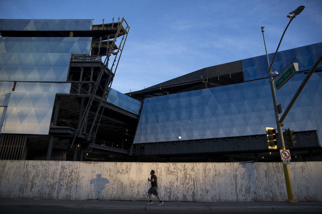 A man runs past the unfinished Fontainebleau resort on the Las Vegas Strip on Wednesday, Dec. 1 ...