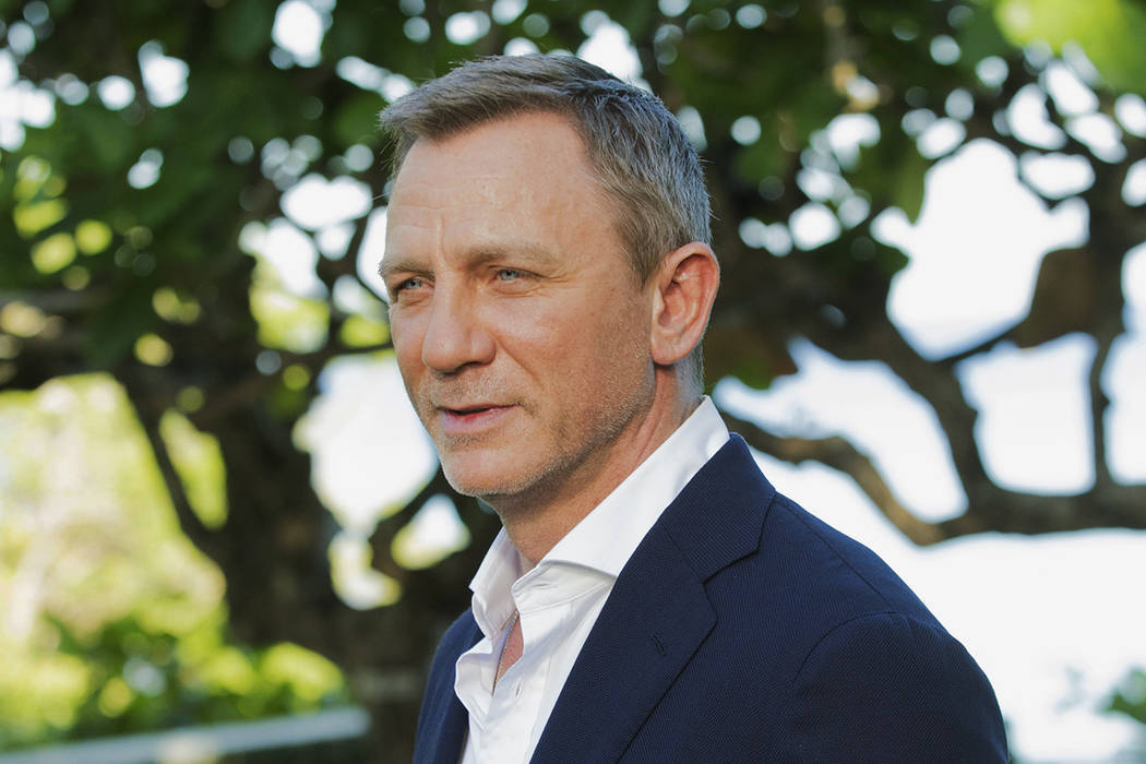 FILE - In this April 25, 2019, file photo, actor Daniel Craig poses for photographers during th ...