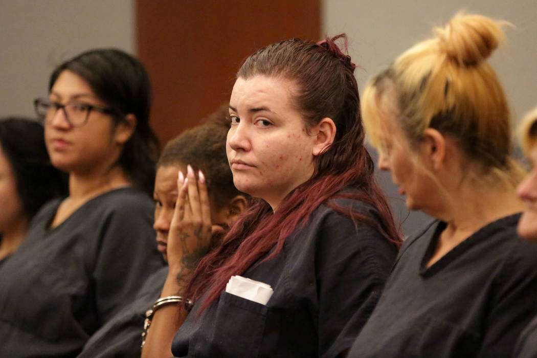 Diana Pena, center, one of three suspects in the killing of a California doctor, appears in cou ...