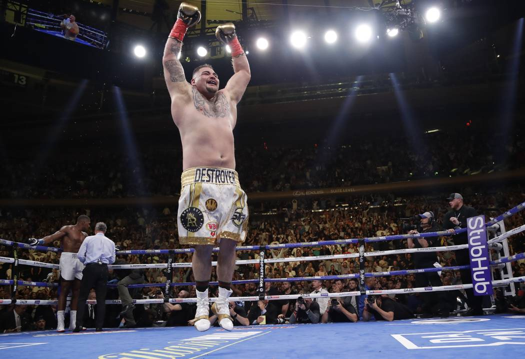 Andy Ruiz celebrates after stopping Anthony Joshua during the seventh round of a heavyweight ch ...
