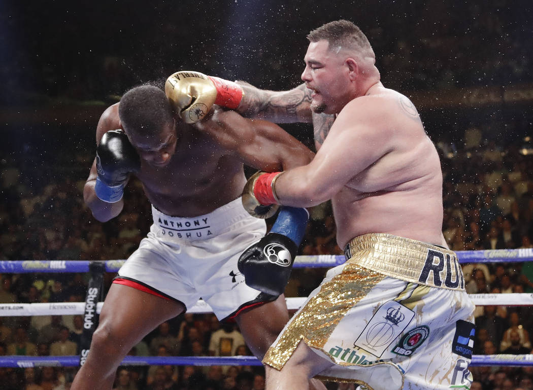 Andy Ruiz, right, punches Anthony Joshua during the seventh round of a heavyweight championship ...