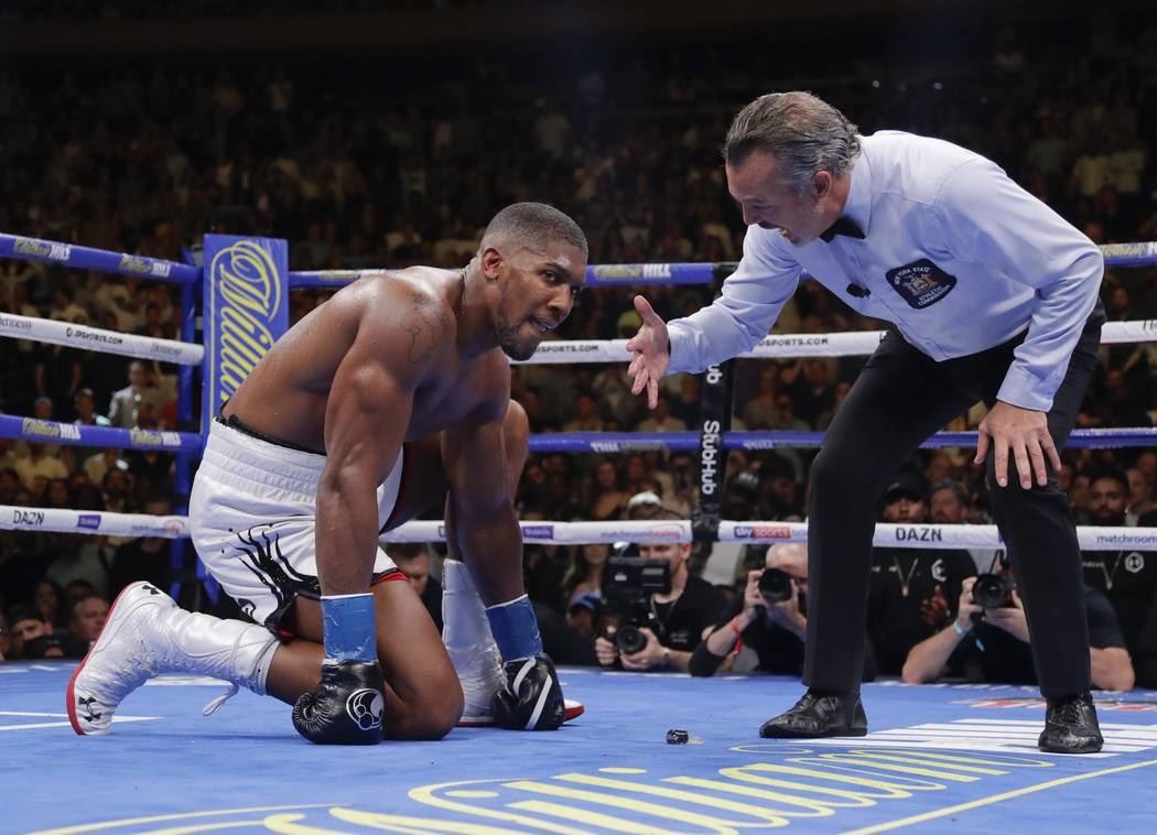 Anthony Joshua waits during the referee's count after he was knocked down during the seventh ro ...