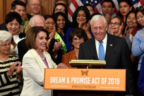 House Speaker Nancy Pelosi of Calif., front left, shakes hands with House Minority Whip Steny H ...