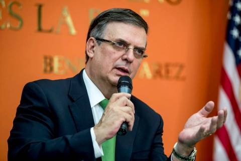 Mexican Foreign Affairs Secretary Marcelo Ebrard, right, speaks at a news conference at the Mex ...