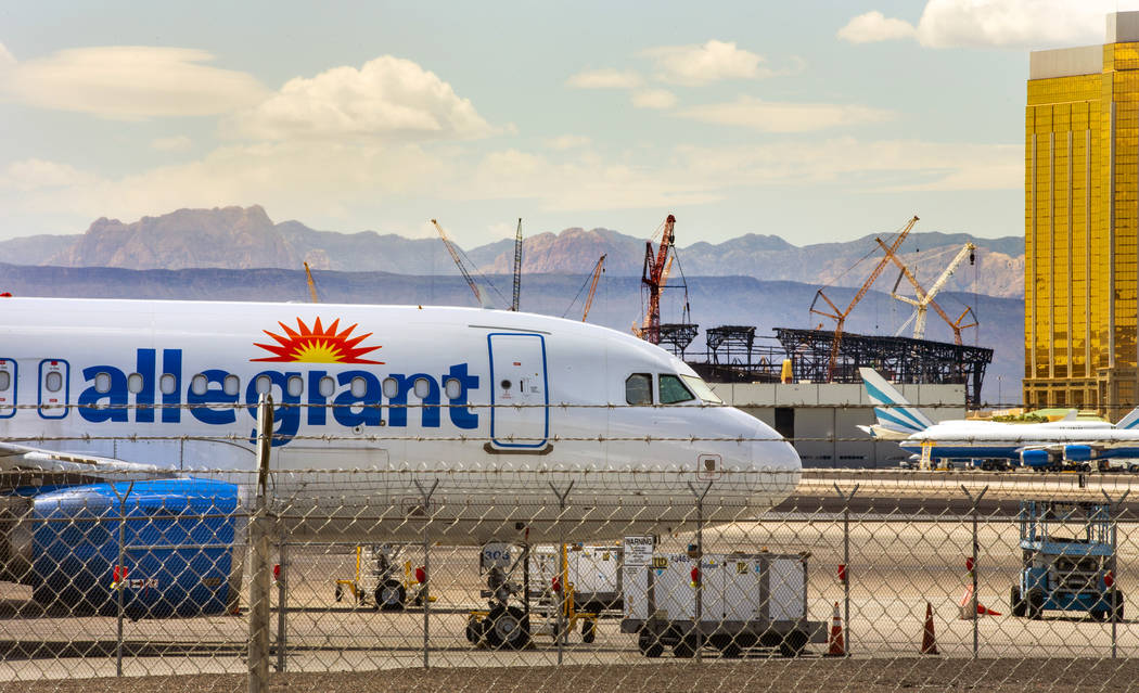 An Allegiant Air plane sits on the tarmac at McCarran International Airport in Las Vegas with t ...