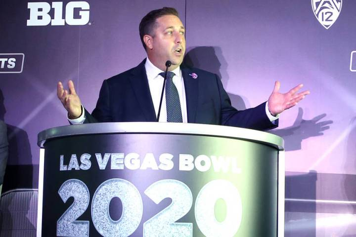 Las Vegas Bowl Executive Director John Saccenti gestures at the announcement for the Mitsubishi ...