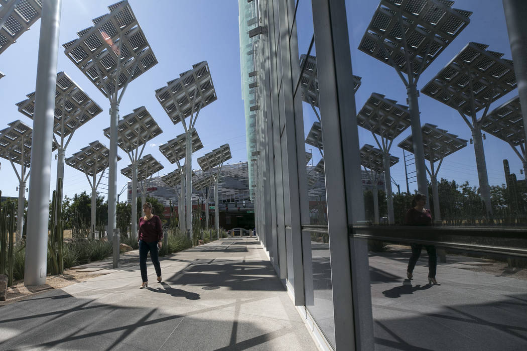 Rows of solar panels soak up the sun's rays outside Las Vegas City Hall in downtown Las Vegas o ...
