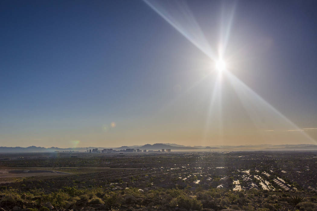 The sun rises over the southwest Las Vegas Valley on Wednesday, June, 5, 2019, in Las Vegas. Th ...