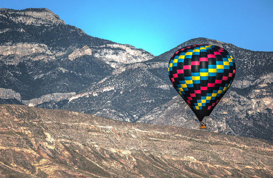 A hot air balloon passes over the southwest Las Vegas Valley on Wednesday, June, 5, 2019, in La ...