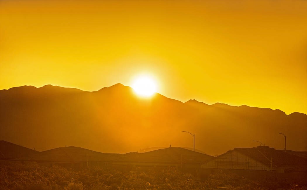 The sun rises in the northwest Las Vegas Valley on Wednesday, June, 5, 2019, in Las Vegas. The ...