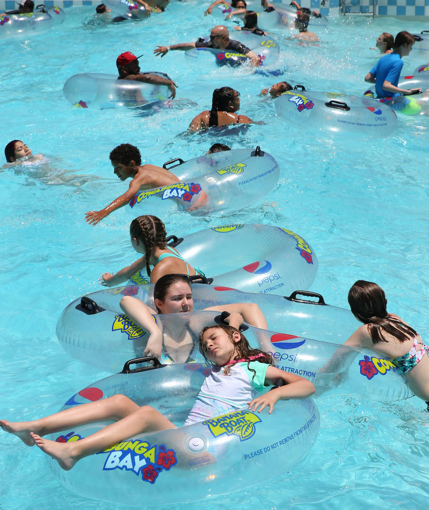 People cool off as they play in the Surf-A-Rama Wave Pool at Cowabunga Bay Water Park in Hender ...