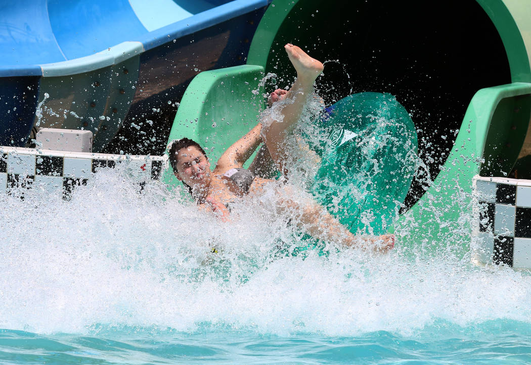 Alex Gentile of Henderson splashes as she rolls down a water slide at Cowabunga Bay Water Park ...