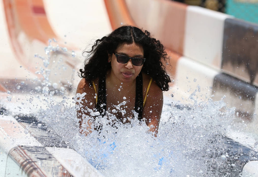 Nathaly Swazo of Las Vegas splashes as she rolls down a water slide at Cowabunga Bay Water Park ...