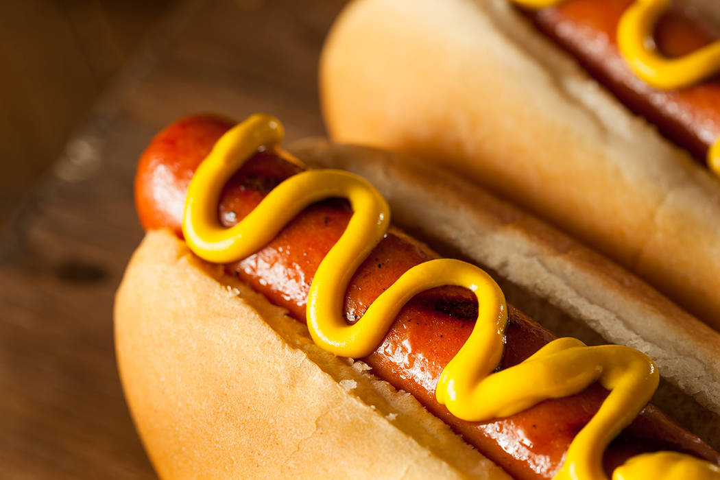 Grilled hot dog with yellow mustard. (Getty Images)