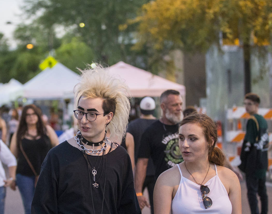 """Jack Moran, left, and Logan Ray explore First Friday's """"Beat Street"""" event on Friday, ..."""