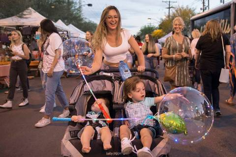 Danielle Kovacs, top/middle, pushes sons Christoper, left, 1, and Johnny, 2, during First Frida ...